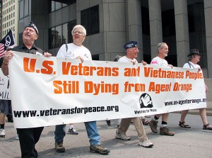 Vets marching with Agent Orange banner