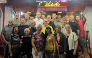 2014 Viet Nam Tour group members led by VFP Chapter 160 poses in front of Ushi's, a world famous restaurant (and personality) located in Hue, Viet Nam.